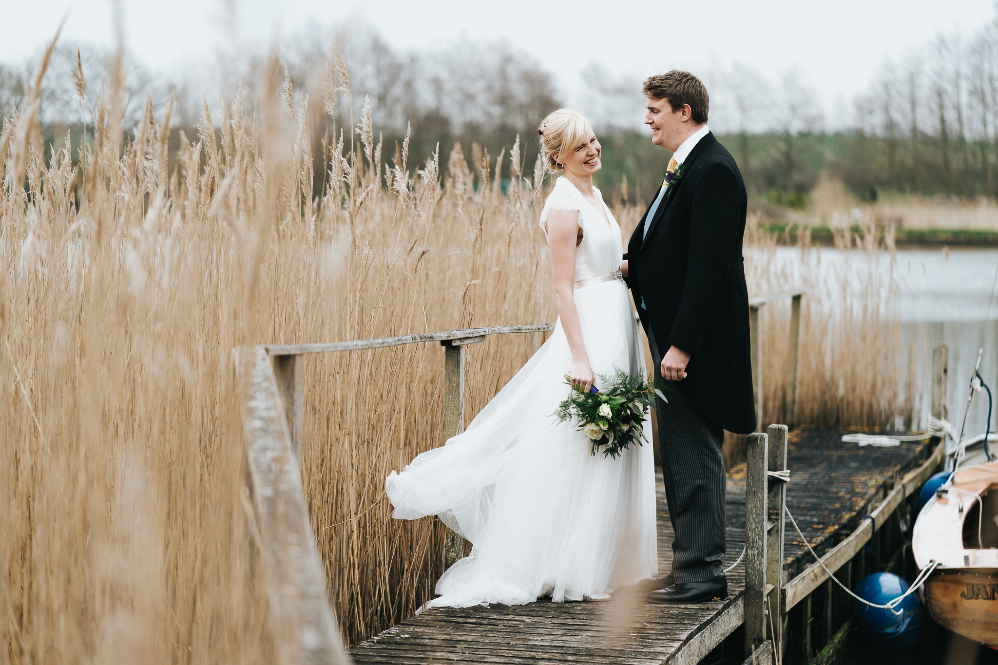 freshwater isle of wight wedding couple standing on jetty