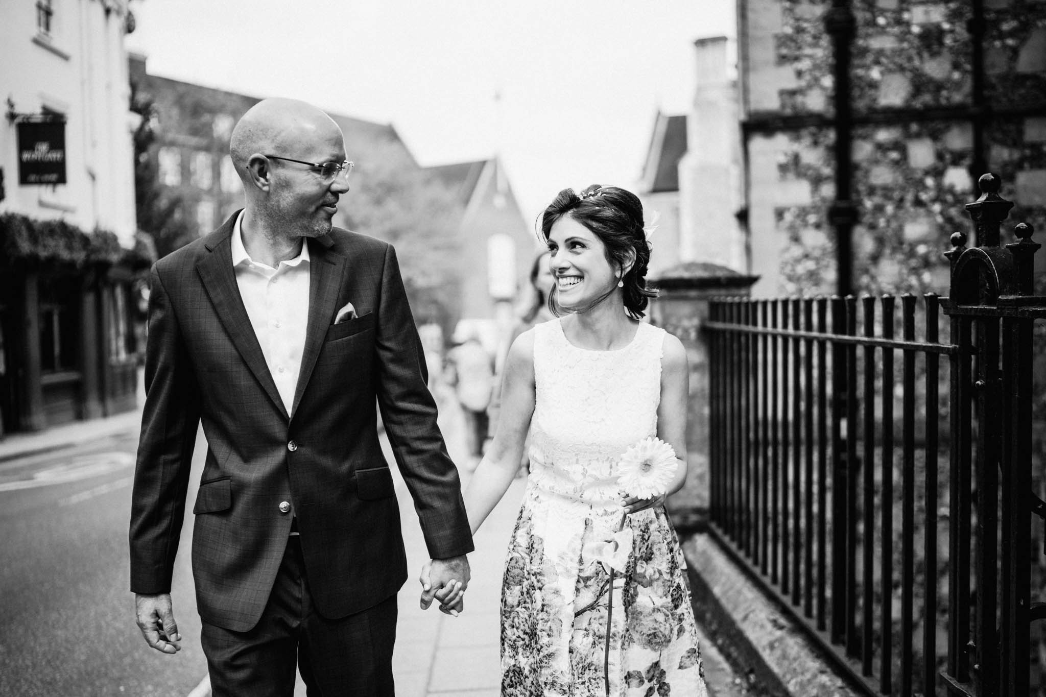 Winchester registry office wedding with couple walking up the road