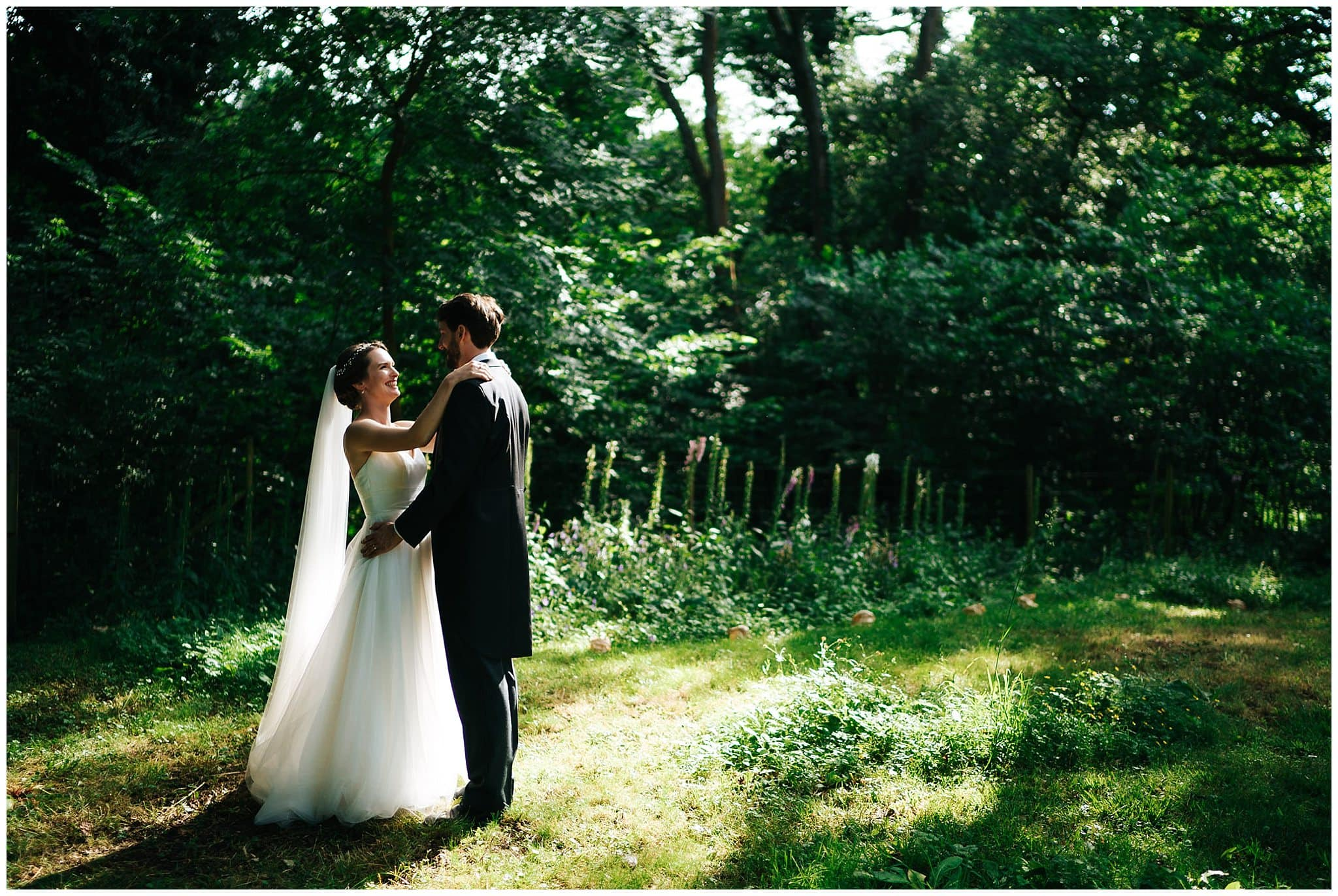 Winchester wedding photography of a couple in a sunlit garden